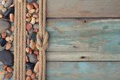 Sea stones with rope — Stock Photo