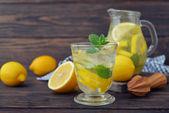 Lemonade with fresh lemon — Stock Photo
