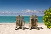 Resting Chairs on the beautiful sandy beach near the sea — Stock Photo