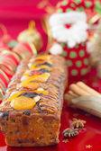 Christmas Fruit-cake with festive decoration, vertical compositi — Stock Photo