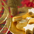 Detail of Christmas cookies with Xmas decoration in gold tone — Stock Photo