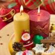 Detail of Christmas cookies with candles on golden plate — Stock Photo #14010586