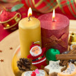Stock Photo: Detail of Christmas cookies with candles on golden plate