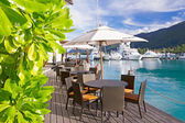 Cozy restaurant on decking by the beautiful marina at Eden Islan — Stock Photo