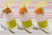 Salmon and avocado mousse on white plate — Stock Photo