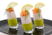 Salmon and avocado mousse on black plate — Foto de Stock