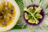 Passion fruit flower with ripe cut passion fruit, macro — Stock Photo