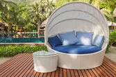 Nice cozy white round chair with canopy and blue cushions — Stock Photo