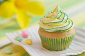 Yellow-green motive cupcake — Stock Photo