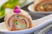 Smock salmon rolls with cucumber and crème fresh on white servi — Foto de Stock