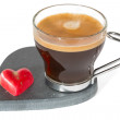 Transparent cup of coffee on stone heart shape soccer, with smal — Stock Photo