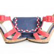 Stock Photo: Pare of trendy navy blue and red shoes, with matching bag, on wh