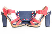Pare of trendy navy blue and red shoes, with matching bag, on wh — Stock Photo