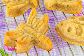 Variety of homemade muffins in shape of butterfly and dragonfly — Stock Photo