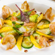 Foto Stock: Prawn salad with mango, smock salmon, cucumber, balsamic vinegar