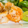 Fresh salad with fried shrimps, variety of salad leafs, mango, a — Stock Photo