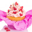 Vanilla cupcake with pink frosting and red hearts — Stock Photo