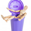 Wooden mannequin doll sitting in purple dustbin can, isolated — Stock Photo
