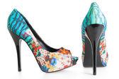 Beautiful multicolored stiletto shoes on white — Stock Photo