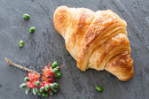 Overhead view of Fresh and tasty croissant on stone gray backgro — Stock Photo