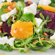 Fresh salad with roasted beetroot, white cheese, orange, and pine nuts — Stock Photo