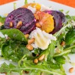 Fresh salad with roasted beetroot, white cheese, orange and pine — Stock Photo