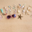 Word summer made from sea shells, with sunglasses and star fish, — Stock Photo #48046955