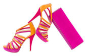 Pare of pink and orange shoes and a matching bag, isolated on wh — Stock Photo