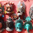 Nepali masks on display in the markets of Bhaktapur, Nepal - Stock Photo