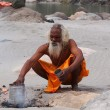 Sadhu on ganges — Stock Photo