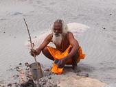 Sadhu on ganges — Stock Photo