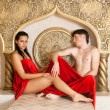 Stock Photo: Young woman and young boy in a Turkish bath