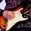 Close up of an electric guitar being played — Stock Photo
