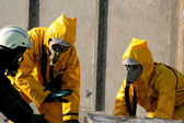 Man in a yellow chemical protection suit — Stock Photo