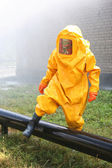 Man in yellow chemical suit — Stock Photo