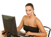 Pretty business woman at office desk — Stok fotoğraf