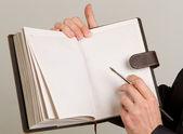 Businessmans hand holding a pen — Stock Photo