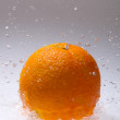 Orange fruits and Splashing water — Stock Photo