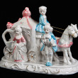 Ceramic figurine in the form of carriage drawn by two horses and — 图库照片