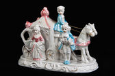 Ceramic figurine in the form of carriage drawn by two horses and — Stock Photo