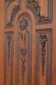 Fragment beautiful carved brown wooden door — Stock Photo
