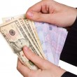 Stock Photo: Hand of a businessman holding a money