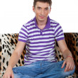 Young guy sitting in the lotus position — Stock Photo #21736367