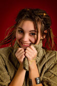 Young woman with dreadlocks on a red background — Stock Photo