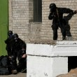 Stock Photo: Anti-terrorist police during black tactical exercises Real si