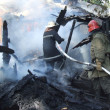 Постер, плакат: Firefighters extinguish a fire in an apartment house