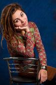 Portrait woman with dreadlocks against a blue background — Stock Photo