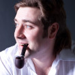 Young man smoking a pipe — Stock Photo #22754449