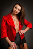 Young brunette in a red jacket — Stock Photo