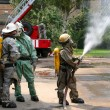 Firefighters in chemical protection suit - Stock Photo